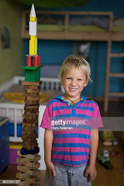 Boy playing with toys indoors