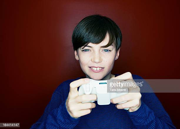 boy playing with video games console