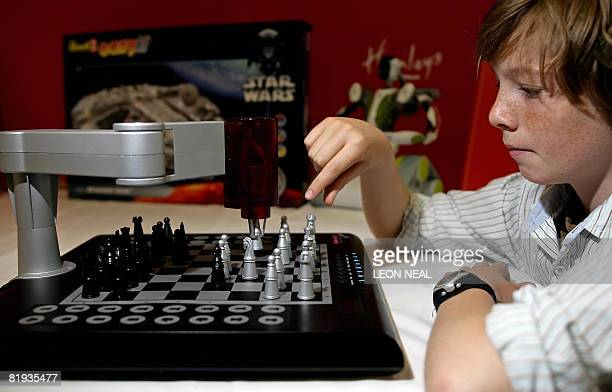 A boy plays against the '2 Robot' robotic chess game at the Hamleys Christmas toy photocall in London on July 15 2008 Hamleys unveiled on Tuesday the...