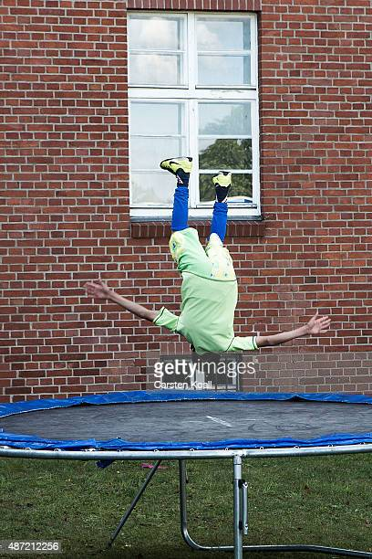 A boy plays at a shortterm housing facility for arriving migrants and refugees in Spandau district on September 7 2015 in Berlin Germany Berlin...