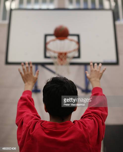 A boy plays basketball in the sports hall at a secondary school on December 1 2014 in London England Education funding is expected to be an issue in...