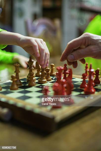 boy plays chess with grandpa,close up