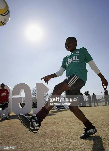 A boy plays football during the 1Goal launch of the Qatar FA project 'Education at Your Feet' at the Wanderers in Illovo on June 23 2010 in...
