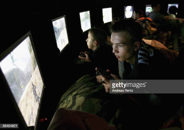 A boy plays games in a dark room at a Playstation game at the Computer Gaming Convention on August 18 2005 in Leipzig Germany The convention is...