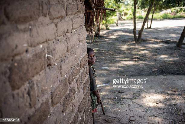 A boy plays hide and seek in the village of Sebele South Kivu on March 22 2015 AFP PHOTO/FEDERICO SCOPPA