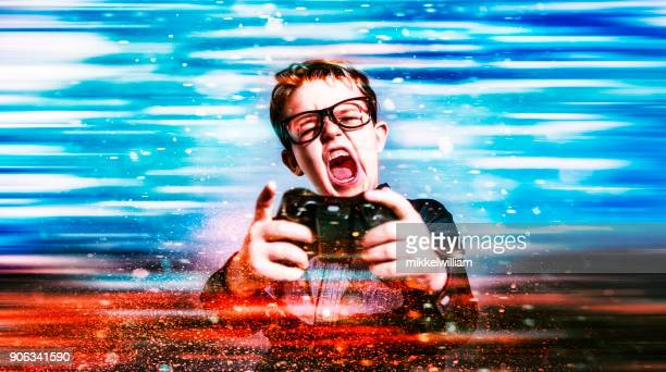 Boy plays immersive video game and shouts as he is about to win