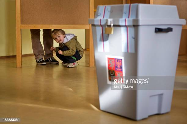 A boy plays in election room during the first day of the Czech early election on October 25 2013 in Prague Czech Republic This early election is...