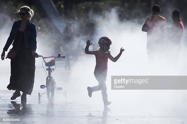 A boy plays in fountain on the street on May 11 2014 in Nice France