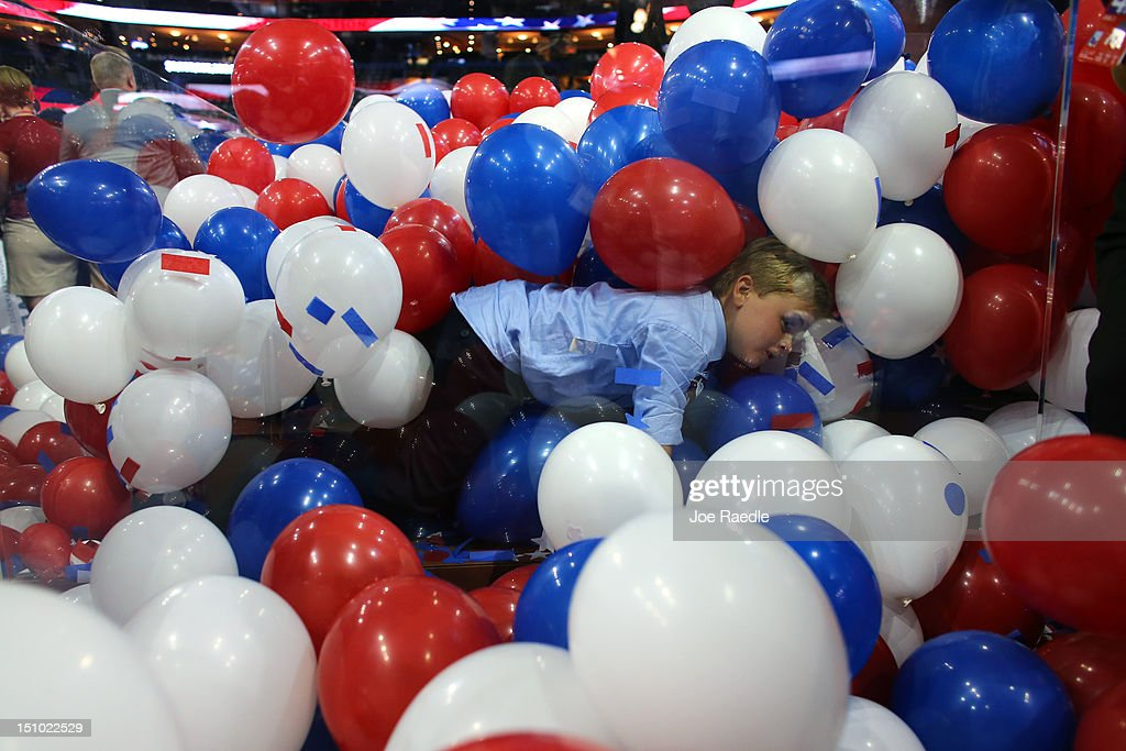 A boy plays in the balloons after Republican presidential candidate, former Massachusetts Gov. Mitt Romney accepted the nomination during the final day of the Republican National Convention at the Tampa Bay Times Forum on August 30, 2012 in Tampa, Florida. Former Massachusetts Gov. Mitt Romney was nominated as the Republican presidential candidate during the RNC which will conclude today.