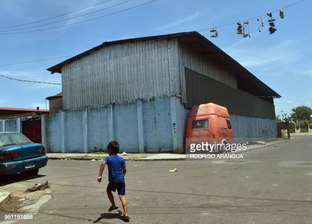 A boy plays in the street at Ruben Dario neighborhood in Managua on April 25 2018 A week of brutally repressed antigovernment protests in Nicaragua...