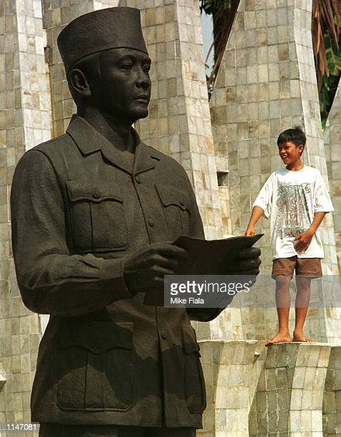A boy plays near a statue of late Indonesian president Sukarno in Proclamation Square in Jakarta Sunday May 25 1997 Sukarno's daughter and ousted...