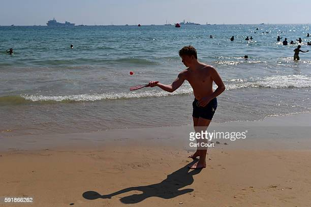 A boy plays on the beach during the Bournemouth Air Festival on August 18 2016 in Bournemouth England The air show runs from the 18th to 21st August...
