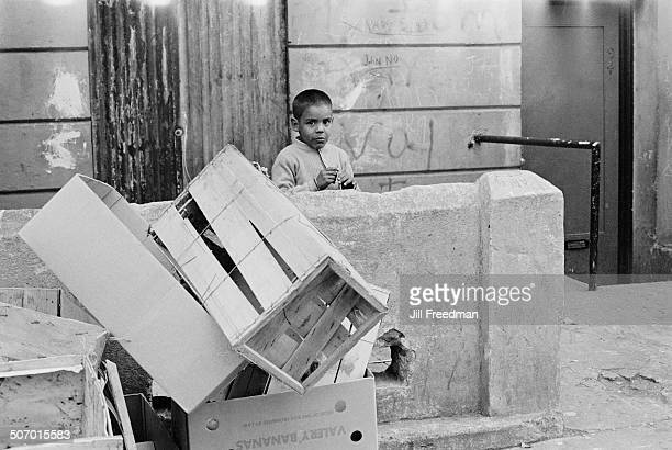 A boy plays outside a tenement building on the Lower East Side New York City USA 1966