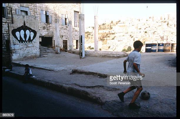 A boy plays soccer in an empty square May 17 1998 in Amman Jordan Still a teenager when crowned in 1952 King Hussein has led the young Arab nation...
