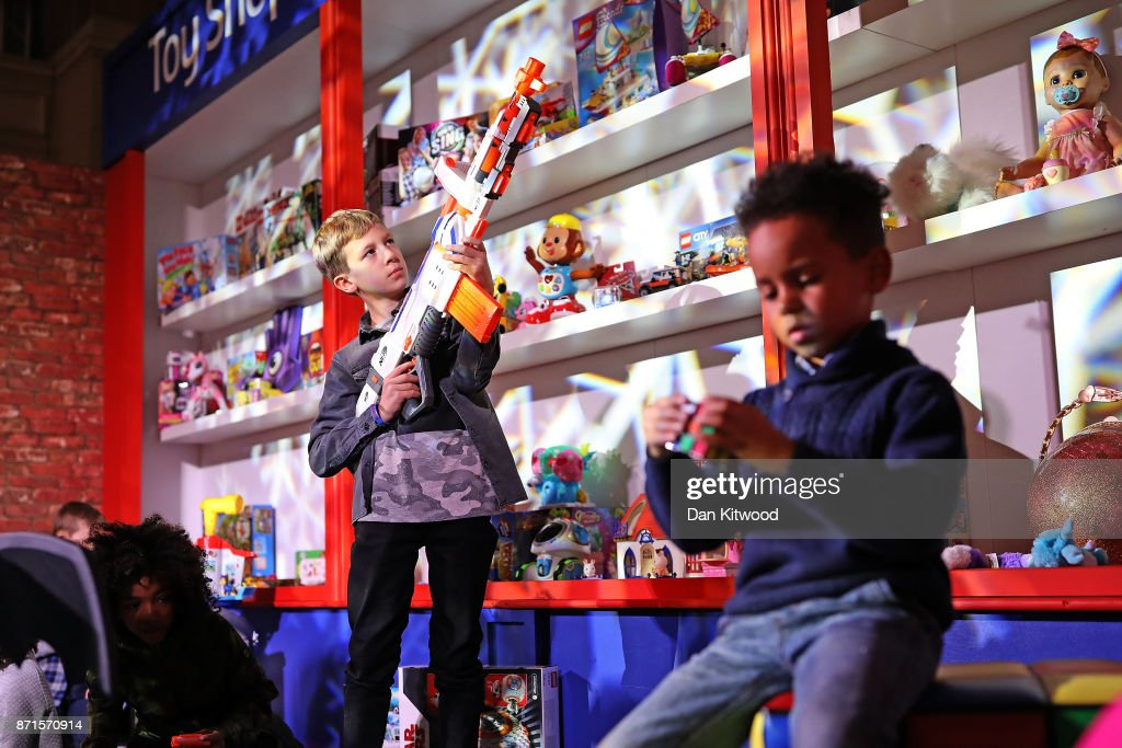 A boy plays with a 'Nerf Modulus Regulator' (left) during a media event announcing the top 12 toys for christmas at St Mary's Church in Marylebone on November 8, 2017 in London, England. The Toy Retailers Association's Dream Toys chart, is an independent list of the predicted Christmas best-selling gifts for children.