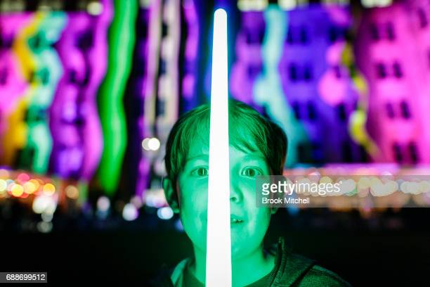 A boy plays with an electric light sabre outside the Museum of Contemporary Art during Vivid on May 26 2017 in Sydney Australia Vivid Sydney is an...