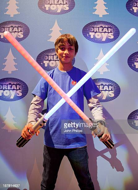 A Boy Plays With The Star Wars Ultimate Force Tech Lightsaber Assortment By Hasbro At The Toy Retailers Association'S Annual 'Dream Toys' Fair On...
