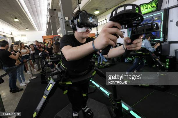 A boy plays with virtual reality during the 21th edition of Napoli Comicon comics review held at the Mostra d'Oltremare in Naples