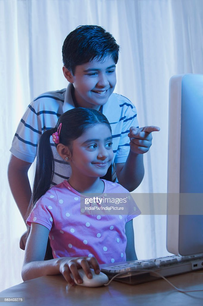 Boy pointing at computer screen : Stock Photo