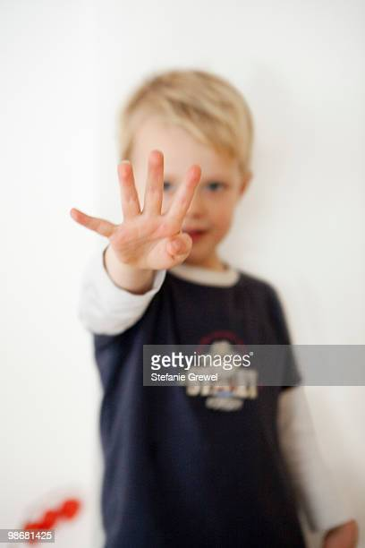 Boy pointing four fingers