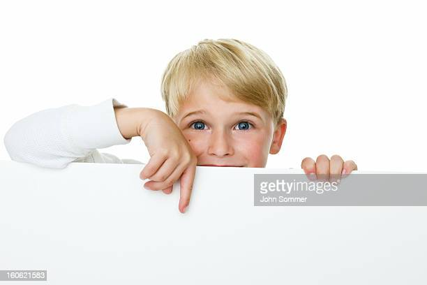 Boy pointing to copy space