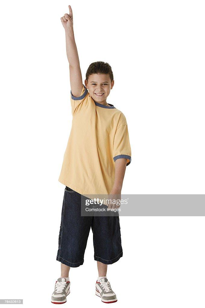 Boy pointing up : Stockfoto