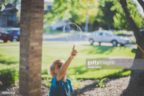 Boy popping bubbles