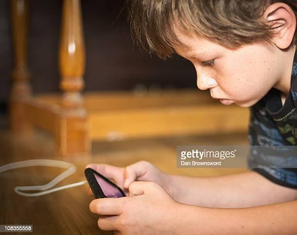 Boy portable gaming on floor