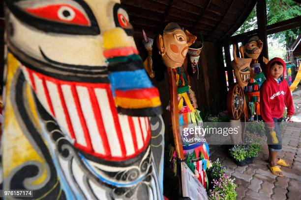 A boy posed with the puppet are wear masks representing the spirits of the dead springing back to life during the annual Phi Ta Khon or Ghost...