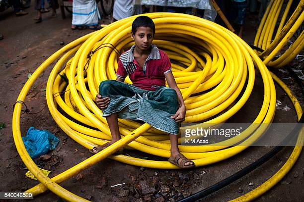 OLD DHAKA DHAKA BANGLADESH A boy poses for a photo in the street during a rainy day the first day of Ramadan in old Dhaka Bangladesh June 07 2016...