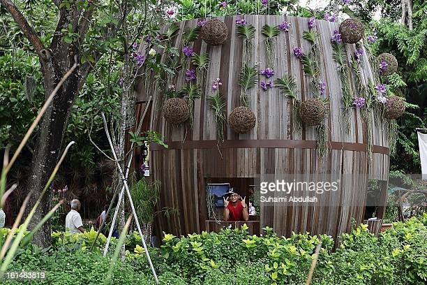 A boy poses for a photograph at the String Garden specially created by Tivoli Gardens of Denmark at the Sentosa Flowers exhibition at Palawan Beach...
