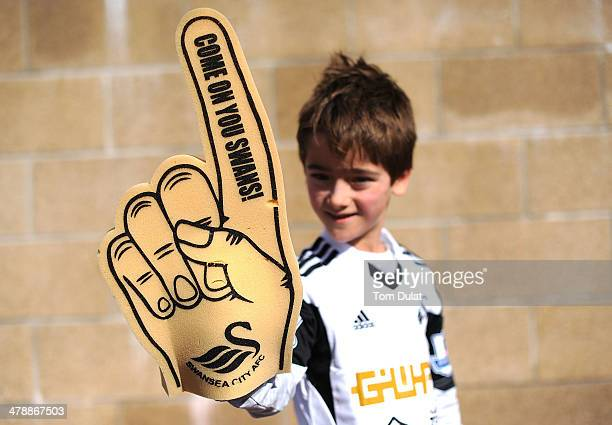 A boy poses for photos prior to the Barclays Premier League match between Swansea City and West Bromwich Albion at Liberty Stadium on March 15 2014...