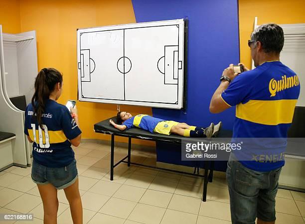 A boy poses in visitors dressing room during Expo Boca Exhibiton at Alberto J Armando Stadium on November 10 2016 in Buenos Aires Argentina