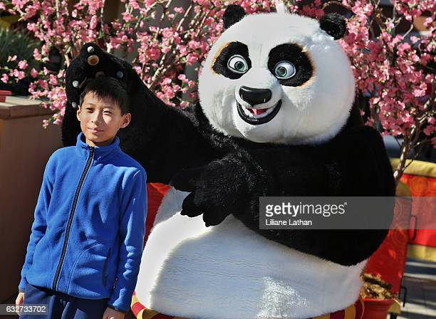 Boy poses with Po from the 'Kung Fu Panda' film series at Universal Studios Hollywood on January 25 2017 in Universal City California