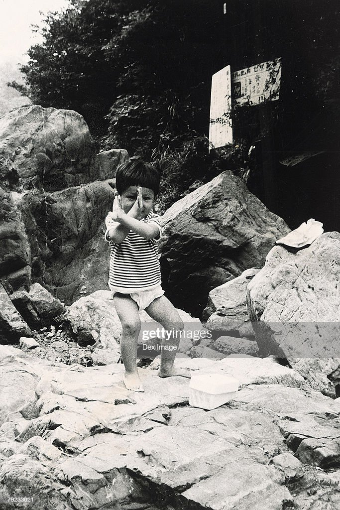Boy posing on rocks : Stock Photo