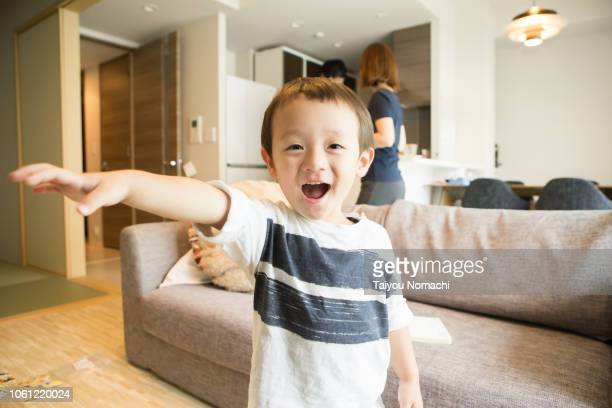 a boy posing towards the camera - childhood stock pictures, royalty-free photos & images