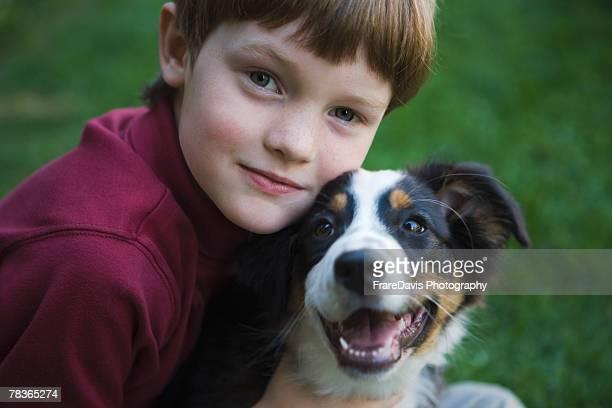 Boy posing with pet dog