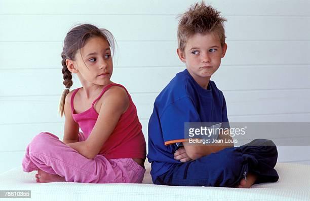 Boy pouting at girl