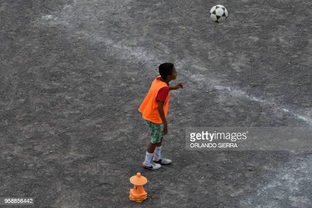 A boy practices football on a field in the poor neighbourhood of Nueva Capital on the outskirts of Tegucigalpa on May 13 2018 Missionaries from the...