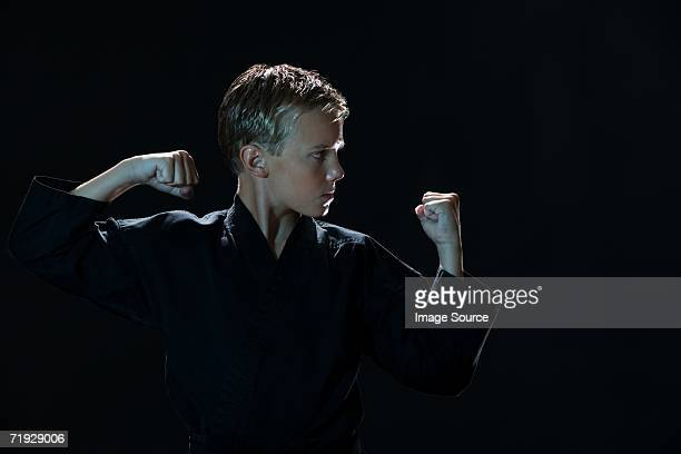 boy practicing karate - combat sport stock pictures, royalty-free photos & images