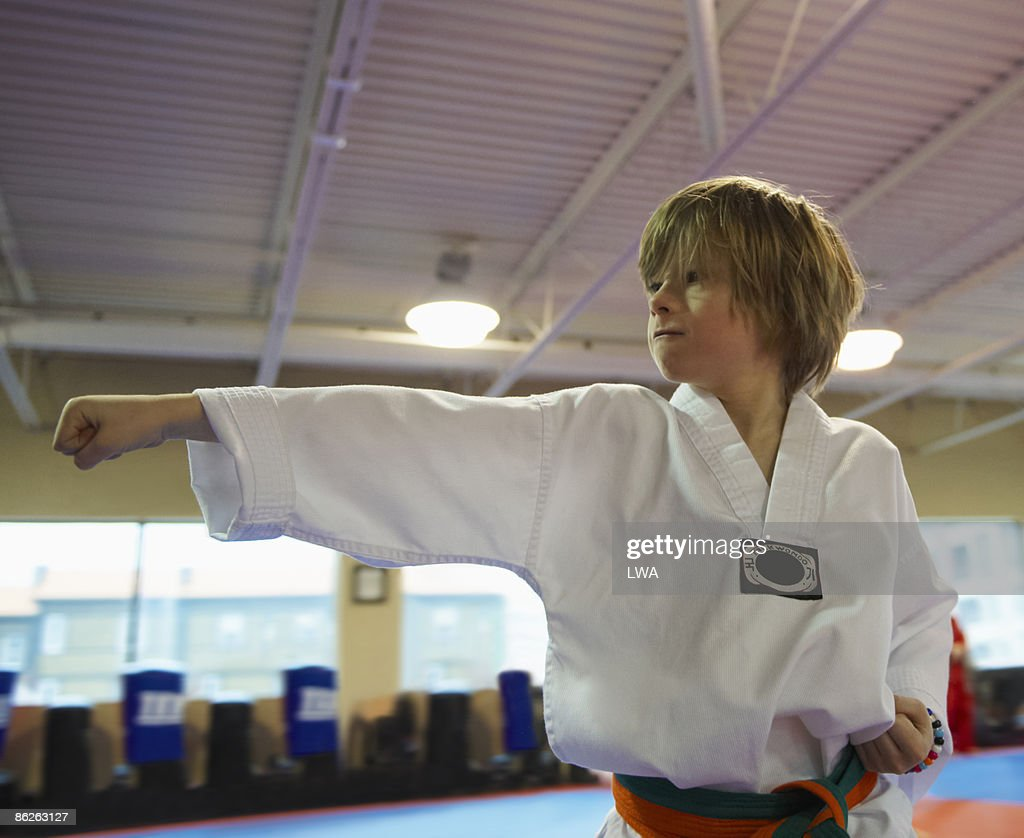 Boy Practicing Tae Kwon Do Punch : Foto de stock