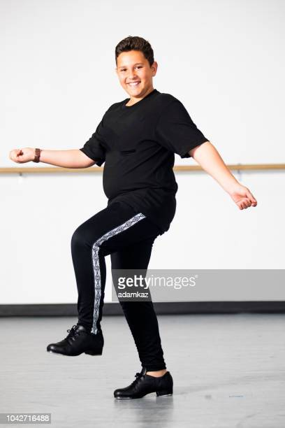 boy practicing tap dancing - cheerleader feet stock photos and pictures