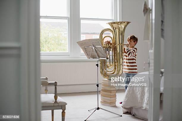 Boy practicing the tuba