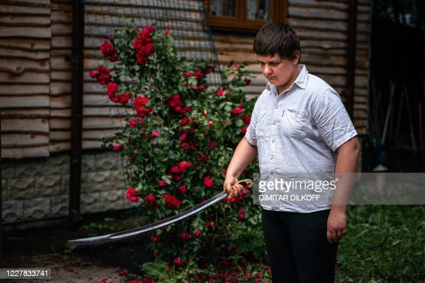 Boy practises during a sword fighting class in the village of Alyaukhovo, some 60 kilometres east of Moscow, on July 8, 2020. - Russians stuck at...