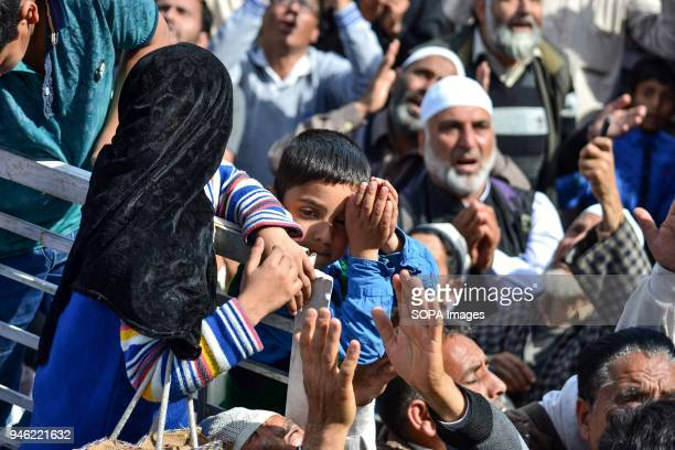 A boy prays on the occasion of the Islamic festival ShabeMeraj at Hazratbal Shrine in Srinagar Indian administered Kashmir ShabeMeraj the night when...
