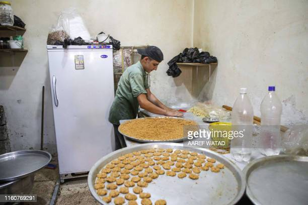 A boy prepares for baking sesamecovered traditional biscuits to be sold on the eve of the Muslim religious festival of Eid alAdha in alDana in...