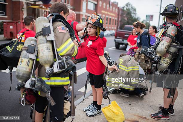 A boy prepares for the 9/11 Memorial Stair Climb in the Brady Sullivan Building in Manchester NH September 11 2016 Participants climb the stairs of...