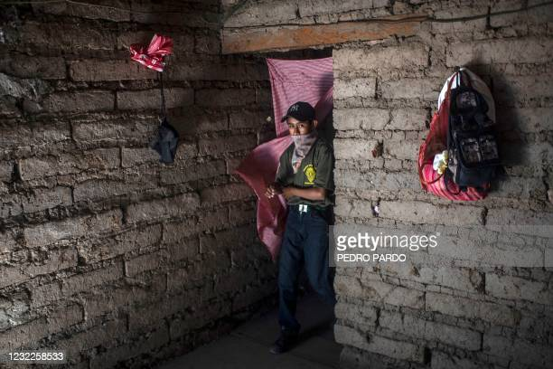 Boy prepares to take part in a training demonstration of the Regional Coordinator of Community Authorities vigilante force, in the village of...