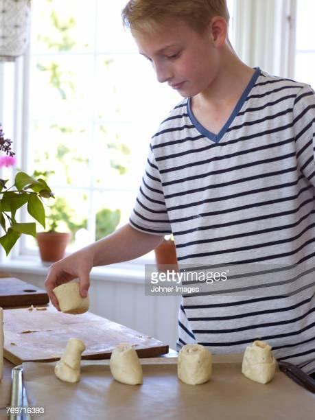 Boy preparing cakes