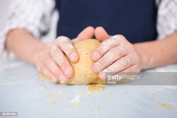 Boy preparing dough